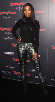 Brandy dazzles in sparkling sequined pants for the AMA After Party.