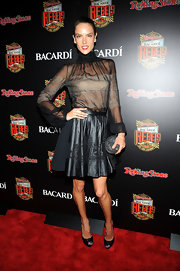 Alessandra Ambrosio showed off just a touch of skin with this sheer blouse that featured a high turtleneck.