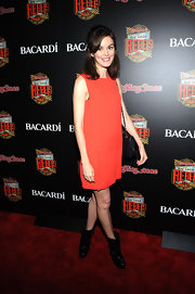Nora Zehetner chose this orange shift dress for her cool mod-inspired red carpet look.
