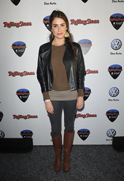 Nikki accessorized her ensemble with brown knee-high leather boots.