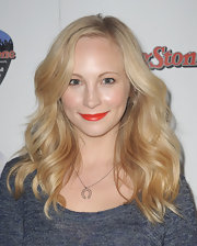 Candice Accola wore a bold red-orange opaque lipstick at the 'Rolling Stone' Super Bowl party.