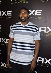 Metta World Peace looked laid-back in a striped v-neck tee.