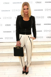 Carrie Keagan showed off her shapely figure in a fitted black leather jacket at the RonRobinson x CO+CO launch party.