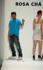"Alexandre is shown here at his runway show sportin some worrn out and rugged ""Air force Ones""."
