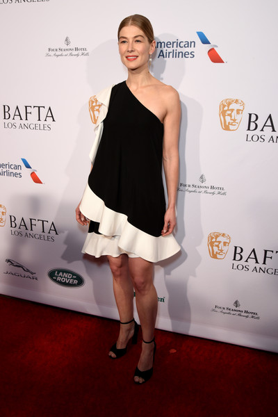 Rosamund Pike Peep Toe Pumps [clothing,dress,cocktail dress,shoulder,red carpet,carpet,fashion,premiere,hairstyle,footwear,rosamund pike,tea party,los angeles,four seasons hotel,beverly hills,california,bbca bafta,bbca bafta tea party]