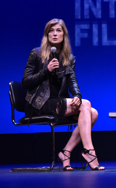 Rosamund Pike Leather Jacket [hamptons international film festival 2018,performance,fashion,sitting,leg,event,thigh,electric blue,performing arts,talent show,long hair,rosamund pike,stage,guild hall,east hampton,new york,hamptons international film festival,q a,a private war]