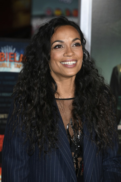 Rosario Dawson Long Curls [hair,hairstyle,long hair,black hair,eyebrow,beauty,lip,forehead,layered hair,ringlet,arrivals,rosario dawson,zombieland double tap,california,regency village theatre,sony pictures,westwood,premiere]