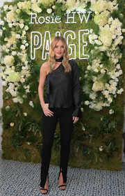 Rosie Huntington-Whiteley launched her Rosie HW x Paige Fall collection wearing a black one-sleeve blouse from the line.