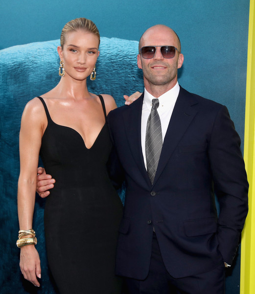 Rosie Huntington-Whiteley Gold Bracelet [warner bros. pictures and gravity pictures premiere,the meg,warner bros. pictures and gravity pictures premiere of the meg,suit,formal wear,fashion,tuxedo,dress,event,little black dress,white-collar worker,cocktail dress,premiere,arrivals,jason statham,rosie huntington-whiteley,california,hollywood,l,tcl chinese theatre imax]