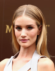 Rosie Huntington-Whiteley opted for a simple center-parted hairstyle when she attended the 25th anniversary Magnum short film launch.