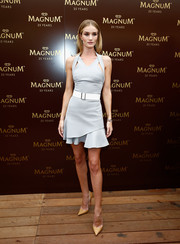 Rosie Huntington-Whiteley was sporty-glam at the 25th anniversary Magnum short film launch in a gray Victoria Beckham mini dress featuring harness-style shoulder straps and a flirty ruffle skirt.