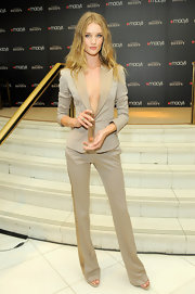 Rosie Huntington-Whiteley wore a fitted khaki suit at the unveiling of Burberry Body fragrance.