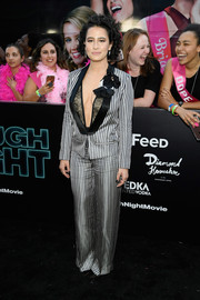 Ilana Glazer stole the spotlight in a flashy Lanvin suit teamed with a plunging lace top at the New York premiere of 'Rough Night.'