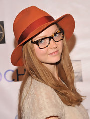 A rust fedora infused some color into Lily Cole's neutral palette at the Six Degrees of Integration exhibition opening.
