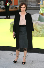 Kristin Scott Thomas kept her look classic and sophisticated with this black loose-fit coat.