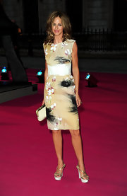 Trinny Woodall paired gold platform sandals with her lovely dress.