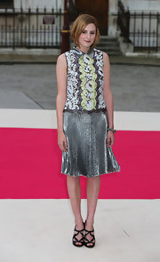 Laura Carmichael dared to bring metallics into summer with this pleated skirt and matchin blouse.