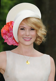 Amanda Holden topped off her outfit for the Royal Ascot with a flower-trimmed white hat from DeDe Valentine.