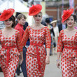 The Tootsie Rollers wear matching outfits and red hats