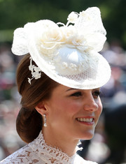 Kate Middleton polished off her look with a pair of pearl and diamond drop earrings.