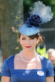 Suzi Perry decided to go the classic route by draping a single strand of pearls around her neck as she attended Day 2 of the Royal Ascot.
