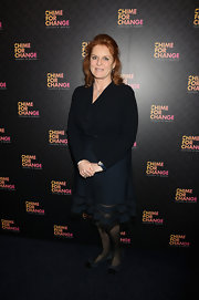 Sarah Ferguson chose a blue ruffled blazer for her look at the 'Chime for Change: The Sound of Change Live' Concert.