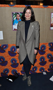 Davina McCall wore a modern taupe wool coat to the White Ribbon Alliance dinner.