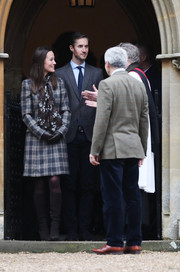 Pippa Middleton covered up in a plaid coat to attend church on Christmas day.