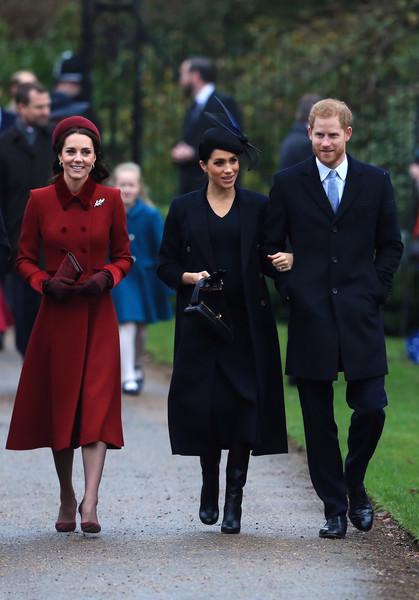 Kate Middleton looked appropriately festive in a red Catherine Walker wool coat with a velvet collar and cuffs during Christmas Day church service.