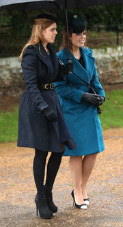 Princess Beatrice paired black platform booties with a navy coat for Christmas day service.