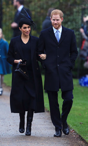 Meghan Markle layered a navy Victoria Beckham coat over a matching midi dress for Christmas Day church service.