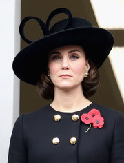 Kate Middleton accessorized with a decorative hat by Philip Treacy on Remembrance Sunday.