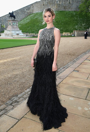 Lily James amped up the glam factor with this beaded and feathered Ralph Lauren gown at the Royal Marsden celebration.