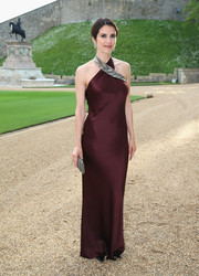 Ksenia Soloveria wore a sleek and sophisticated burgundy halter gown to the Royal Marsden celebration.