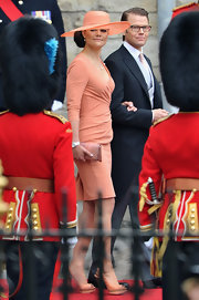 Princess Victoria looked lovely in a peach faux wrap cocktail dress for the royal wedding.