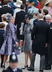 Zara Phillips was sleek in silver at the royal wedding in a modern over coat and Mary Jane pumps.