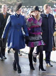 Autumn Phillips wore stunning black knee high boots to attend Christmas Day service at Sandringham.