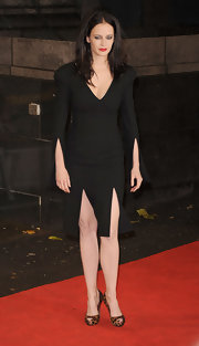 Eva Green looked darkly dramatic in a black strong-shouldered dress with double front kick slits and matching elbow-high slits.