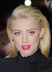 Amber's shocking pink lip look can be recreated with NARS lipstick in Schiap, a nod to Italian fashion designer Elsa Schiaparelli's favored shade.