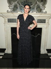 Rumer Willis looked prim and proper in a black micro-print gown with flutter sleeves while posing for photos after her Cafe Carlyle performance.