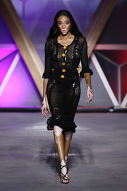 Winnie Harlow walked the Fashion for Relief runway looking sultry in a sheer black crochet dress.