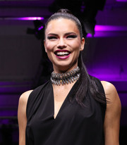 Adriana Lima jazzed up her look with an oversized choker.