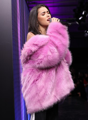 Madison Beer performed at the Maybelline Urban Catwalk show wearing a bulky pink fur coat.
