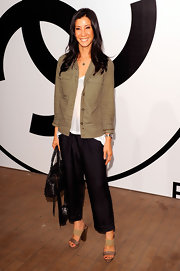Lisa Ling casually topped her thin white T-shirt with a loose-fitting multi-pocketed khaki jacket at the RxArt Party.