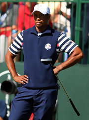 Tiger Woods chose a navy pullover vest for his athletic but preppy on-the-course look.