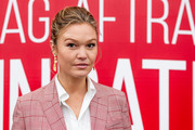 Julia Stiles attended the SAG-AFTRA Foundation Converation: 'Hustlers' wearing her hair in a messy updo.