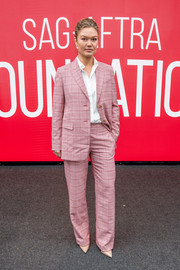 Julia Stiles suited up in a pink grid-patterned jacket and pants combo for the SAG-AFTRA Foundation Conversation: 'Hustlers.'