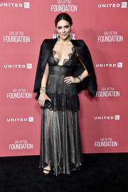 Katharine McPhee polished off her ensemble with a black satin clutch.