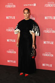 Tracee Ellis Ross went for classic glamour in a vintage Balmain gown with embroidered, puffed sleeves at the SAG-AFTRA Foundation Patron of the Artists Awards.