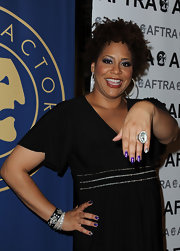 Kim Coles wore vibrant purple polish with a single metallic silver nail at the 2011 Tri-Union Diversity Awards.